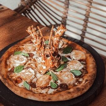 Pizzas y más en restaurante Vagalume Tulum